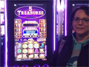 Woman standing in front of slot machine